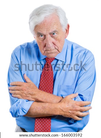 Closeup portrait of serious senior unhappy grumpy businessman with scowling expression on his face, isolated on white background. Human emotions, facial expressions, feelings, personalities, character - stock photo