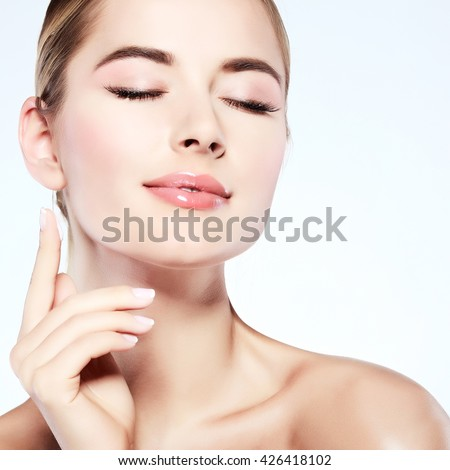 Closeup portrait of sexy whiteheaded young woman with beautiful blue eyes isolated on a light-grey background, emotions, cosmetics