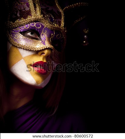 closeup portrait of sexy woman in violet party mask for desire concept - stock photo