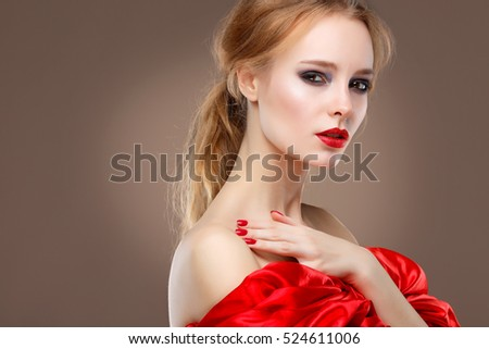Closeup portrait of sexy young woman with beautiful red lips  in red clothes