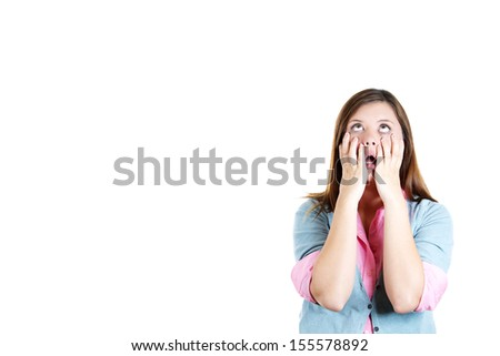 Closeup portrait of shocked, horrified, attractive and worried and stressed girl with hands on face, isolated on white background with copy space - stock photo