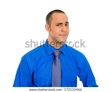 Closeup portrait of skeptical young man looking suspicious and disgusted on face, mixed with disapproval, isolated on white background. Negative human emotion, facial expressions, feelings - stock photo