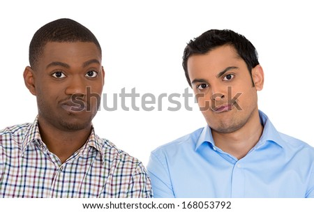 Closeup portrait of skeptical young men looking at camera with suspicion and disgust on face, mixed with disapproval, isolated on white background. Negative human emotion, facial expressions, feelings - stock photo