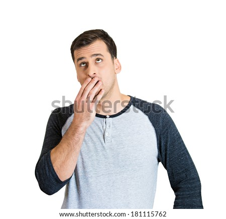 Closeup portrait of sleepy guy, bored young man, tired student placing hand on mouth yawning, eyes open, isolated on white background. Human emotions, facial expressions, feelings, body language - stock photo
