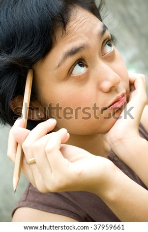 Closeup portrait of smart young woman thinking
