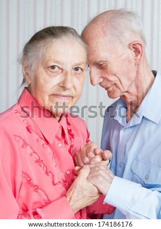 Closeup portrait of  smiling elderly couple Old people holding hands.