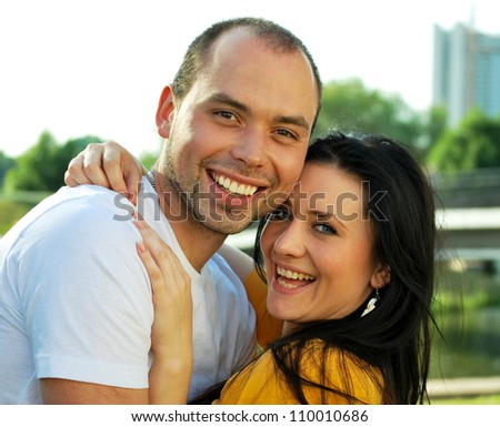 Closeup portrait of smiling young couple in love - Outdoors
