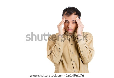 Closeup portrait of stressed and depressed man with headache, isolated on white background with copy space. Negative emotion facial expressions. - stock photo