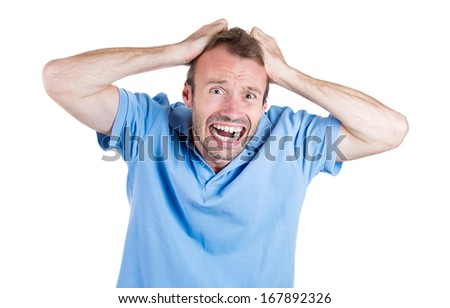 Closeup portrait of stressed, frustrated, crazy man, pulling his hair out, having panic attack, isolated on white background. Negative human face expressions, emotions, feelings, attitude, perception - stock photo