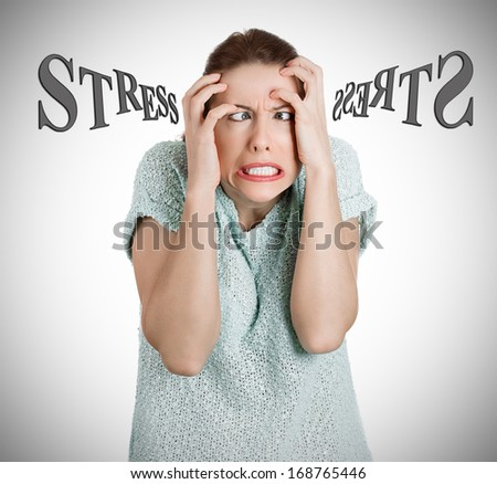 Closeup portrait of stressed, overwhelmed screaming young woman, student, worker, squeezing head with hands, isolated on grey background. Negative human emotions, face expressions, feelings, reaction. - stock photo