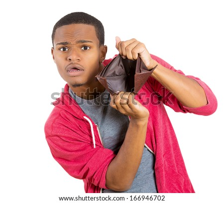 Closeup portrait of stressed, upset, sad, unhappy young man standing with, looking into empty wallet, isolated against white background. Financial difficulties, bad economy concept. Negative emotion - stock photo