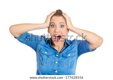 Closeup portrait of surprised young lady, shocked woman, looking at you camera with wide opened mouth, eyes, hands on head, isolated on white background. Positive human emotions, facial expressions