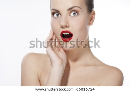 Closeup portrait of surprised young woman on white background - stock photo