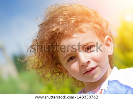 Closeup portrait of sweet adorable child outdoors, have fun in the park, relaxation on backyard, active childhood, happiness concept - stock photo
