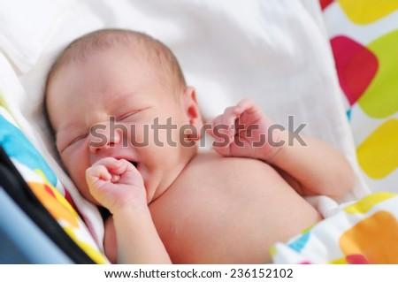Closeup portrait of sweet newborn baby  - stock photo