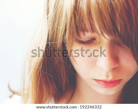 Closeup Portrait of Teenage Girl look sad, toning effect - stock photo