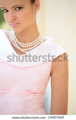 closeup portrait of the cute girl with pearl necklace, with copyspace - stock photo