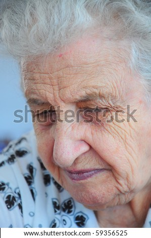 Closeup portrait of tired and sad senior woman - stock photo