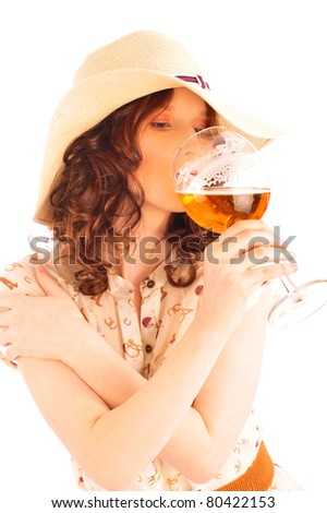Closeup portrait of trendy pretty woman wearing stylish dress holding glass of beer and drinking