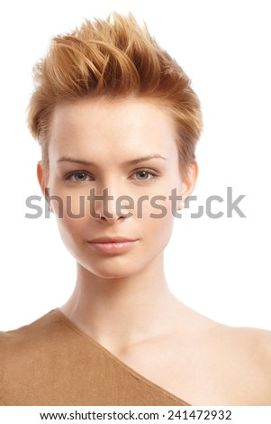 Closeup portrait of trendy woman with short gingerish hair. - stock photo