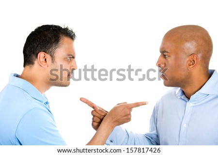 Closeup portrait of two angry guys pointing fingers at each other and blaming for problems, isolated on white background. Interpersonal conflict resolution. Human emotions and facial expressions. - stock photo