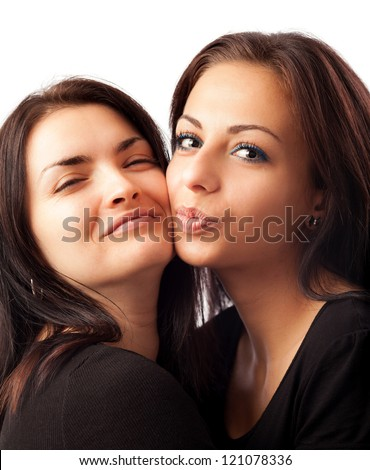 Closeup portrait of two happy young girlfriends isolated on white background - stock photo