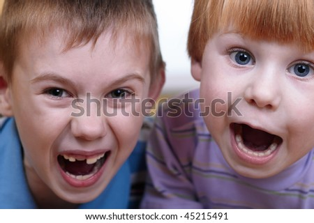 closeup portrait of two little boys - stock photo