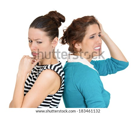Closeup portrait of two people, couple woman and young lady, back to back, very sad, disappointed with each other, isolated white background. Negative human emotion facial expression,feelings - stock photo