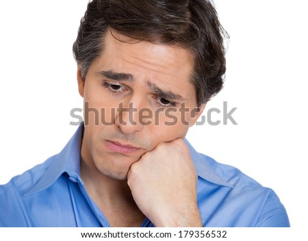 Closeup portrait of unhappy guy, sad, thoughtful young business man thinking, daydreaming deeply, bothered by mistakes, hand on head looking downwards, isolated on white background. Negative emotions - stock photo