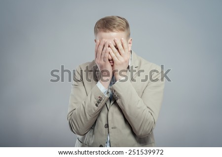 Closeup portrait of unhappy guy, sad thoughtful young business man thinking deeply, bothered by mistakes, hand on head looking downwards, having headache . Negative emotion - stock photo