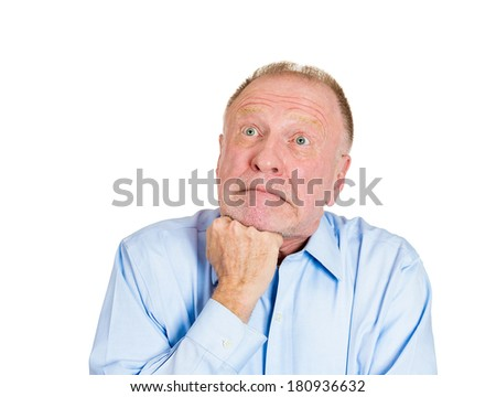 Closeup portrait of unhappy, sorry guy, sad, senior mature business man thinking, daydreaming deeply, bothered by mistakes, hand on chin looking up, isolated on white background. Negative emotions - stock photo