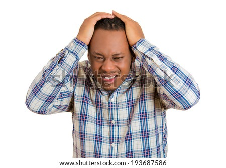 Closeup portrait of upset, frustrated, overwhelmed, stressed young man squeezing his head, going nuts, depressed, losing mind, isolated white background. Negative emotions, facial expressions feelings - stock photo