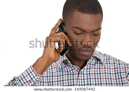 Closeup portrait of upset, sad, depressed, worried young man, student, son, father, worker talking on the phone, isolated on white background. Human face expressions, emotions, feelings, reactions - stock photo