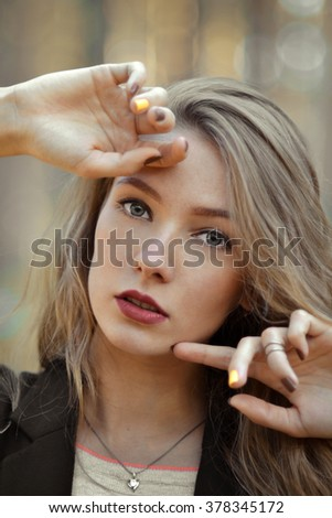 Closeup portrait of very beautiful,attractive stunning,perfect girl.Fashionable girl with opened mouth,hands near the cute,nice face,light,white,pure skin,red lips,shiny,light,long,perfect hair,trend. - stock photo