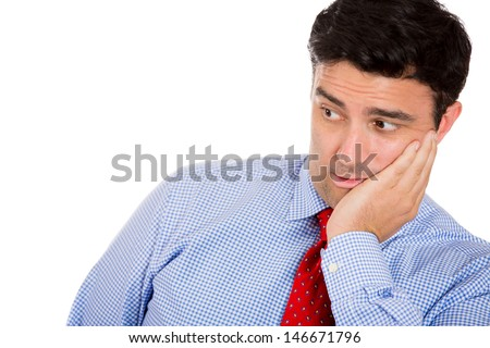 Closeup portrait of wild, goofy, crazy, funny, shocked man's face looking to side with copy space, isolated on white background