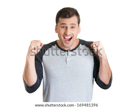 Closeup portrait of winning successful young man, happy ecstatic celebrating, fists pumped, isolated on white background. Positive human emotions, facial expressions. Life achievement concept - stock photo