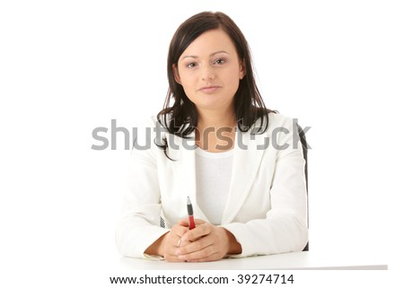 Closeup portrait of woman sitting at the desk isolated