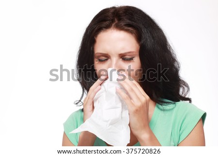 Closeup portrait of woman sneezing or using towel to wipe snot from her nose, isolated on white background with copy space - stock photo