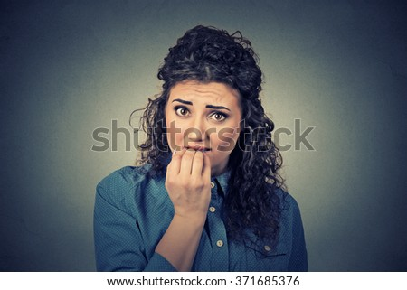 Closeup portrait of worried woman - stock photo