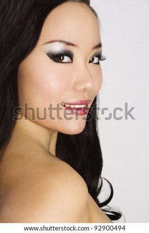 Closeup portrait of Young and Beautiful asian woman. Not isolated. - stock photo