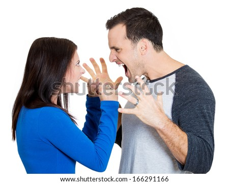 Closeup portrait of young angry couple, man, woman, screaming at each other, blaming for problem, isolated on white background. Marriage difficulties concept, negative emotions, expressions, feelings - stock photo