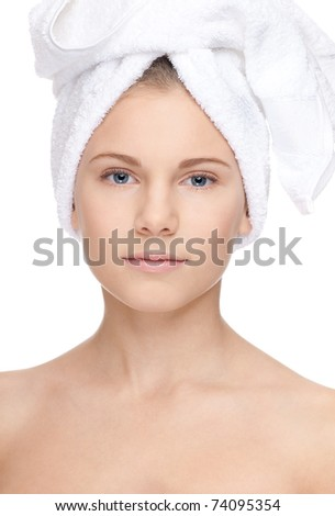 Closeup portrait of young beautiful girl with perfect skin and towel on head. Visage. Isolated on white