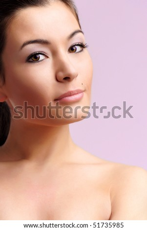 Closeup portrait of young beautiful woman - stock photo