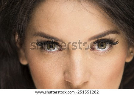 closeup portrait of young beautiful woman with natural makeup over black background - stock photo