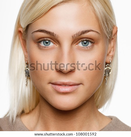 Closeup portrait of young blond female with nude makeup - stock photo