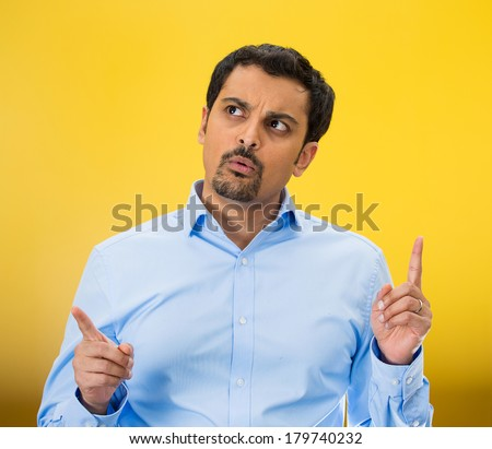 Closeup portrait of young business man thinking, daydreaming, trying hard to remember something looking confused, isolated yellow background. Negative emotion facial expression. Short-term memory loss