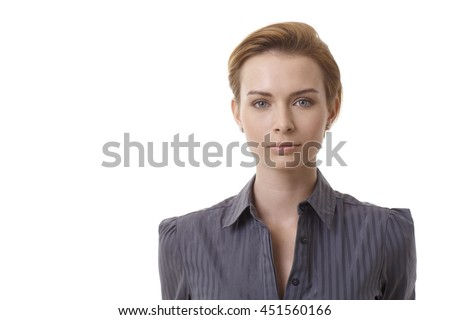 Closeup portrait of young businesswoman looking at camera.
