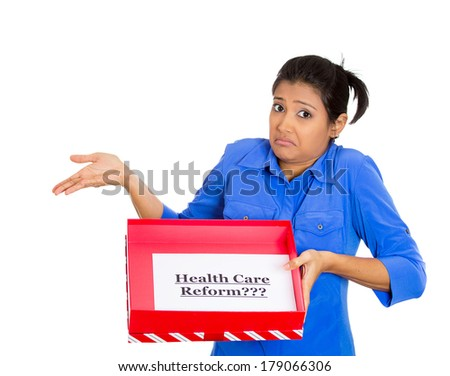Closeup portrait of young confused skeptical woman holding a sign health care reform in gift box, uncertain of universal insurance coverage, isolated white background. politics, government legislation - stock photo