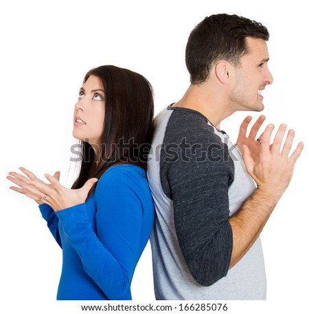 Closeup portrait of young couple, man, beautiful woman standing with backs together, angry not listening to each other isolated on white background. Negative human emotions facial expressions feelings - stock photo