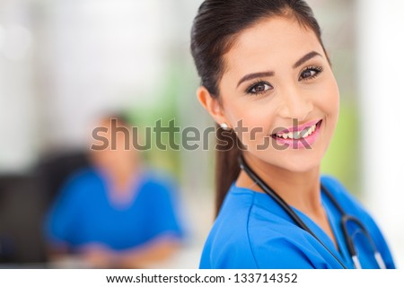 closeup portrait of young female medical worker in office - stock photo